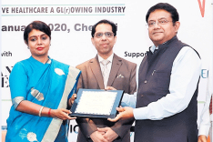 Girish Radhakrishnan, CMD, UIIC, receiving the award for Best Insurance Company in implementing the Govt. Health Schemes